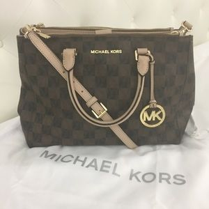Michael Kors purse over shoulder or hand held